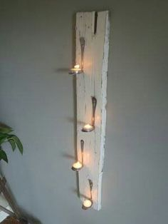 Bent spoons to hold tealights - so cute and cheap. Nice on a deck or all weather/sun room