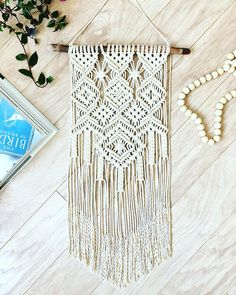 This Handmade Macrame Wall Hanging is made with 100% unbleached natural cotton rope 3mm and hung on a forest driftwood. This will add such a tasteful and stylish element to your home. Imagine how unique your space will look with this hanging in it. It looks great over chests,