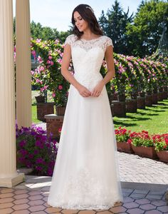 Sincerity wedding dress style 3914 A classic look created by a Sabrina neckline, natural waistline, and chapel length train. Beaded and corded lace completes this demure look.
