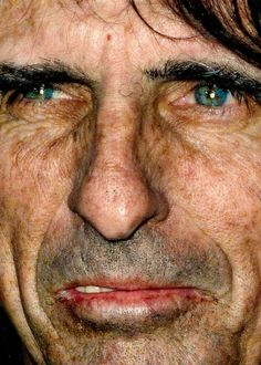 Dangerous Minds | It's Not the Age, It's the Mileage: Extreme close-up pics of aging rock stars... this is Alice Cooper, I think this picture is magic. He's an amazing guy with a big heart. I think that this pic of him is the only one in the series that doesn't look like a troll. His eyes are beautiful!