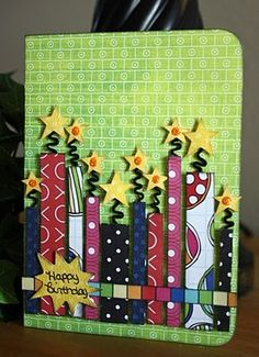 great bday card idea to use up those paper scraps. Like the curly wicks.