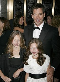 Harry Connick Jr. and daughters - they're alladorable.  Heard snippets from his cd due out the 11th verrrrry nice.