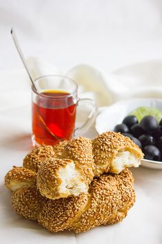 Simit Turkish Bagels. Similar to American bagels but is not boiled before baking. Great for breakfast, Light, and perfect with olives and feta cheese. Get the recipe here: http://www.munatycooking.com/2016/12/simit-turkish-bagels.html