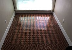 Wondering what to do with that jar of pennies collecting dust in the back of your cupboard? Well, we've finally found a good use for them thanks to Tonya Tooners. The Portland, Oregon-based DIY enthusiast used over 13,000 coins to make a beautiful patterned floor in her house, and as you can see, it's worth every penny! Show Full TextShe made it using three $50 bags of pennies from the bank, along with some Elmer's glue (ok, ten bottles of Elmer's glue to be precise), wood filler, grout…