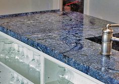 Blue Bahia granite is a stone that is legendary for its beauty. It is possibly the bluest granite on the market, and it is in very high demand. It is quarried Blue Kitchen Countertops, Cheap Countertops, Formica Countertops, Butcher Block Countertops, Bathroom Countertops, Concrete Countertops, Faux Granite, Granite Tops, Wooden Counter