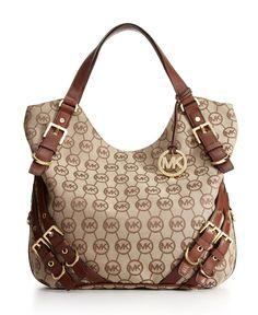 I ADORE my Michael Kors bag, but I would loove to own this one! I choose MK over Coach any day! ;) ...MICHAEL Michael Kors Handbag