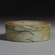 Shaker Light Blue-painted Oval Covered Box, probably New England, 19th century, pine top and bottom with bent maple sides, the cover joined with a slender finger facing right, the box joined with two fingers facing left, each finger with finely chamfered edges, and nailed with copper tacks, mellow worn painted surface, ht. 3, 6 1/2 x 8 1/2 in. skinner