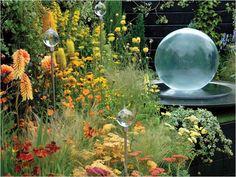 42 Amazing Whimsical Garden Ideas 33 Wildflower Garden with Spherical Sculpture 2
