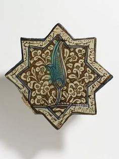 Tile      Place of origin:      Kashan, Iran (made)     Date:      early 14th century (made)     Artist/Maker:      unknown (production)     Materials and Techniques:      Fritware, gl