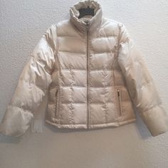Champagne puffer coat Beautiful champagne colored puffer coat. Worn once, so is basically new with tags. This is a size large but runs small so I've labeled it a medium. Polyester lining, down and polyester filling. Apt. 9 Jackets & Coats Puffers