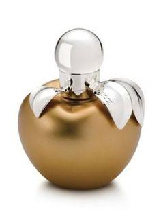 Nina Ricci Gold Perfume .