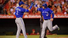 Toronto Blue Jays third baseman Josh Donaldson, right, is congratulated by shortstop Troy Tulowitzki after scoring on a triple by Jose Bautista during the fourth inning in Anaheim on Saturday night. Devon Travis, Troy Tulowitzki, Josh Donaldson, Toronto Star, Toronto Blue Jays, Texas, Baseball, Sports Teams, Saturday Night