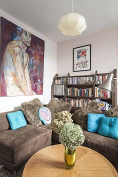 The autumnal tones in the living room are given a colour boost with the pop of teal cushions
