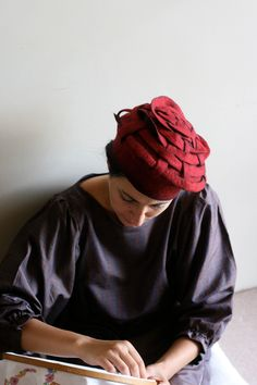 Absolutely gorgeous! Wearable art for sure!  Felt Hat 1 : handmade OOAK red wearable sculpture. $350.00, via Etsy.