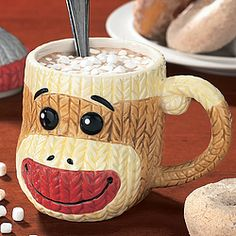 His little hat doubles as the mug's lid, keeping your beverage warm. Looks darn cute on your collectibles shelf, too!