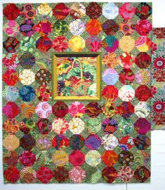 gorgeous snowball quilt top (without the outer border) with a central framed basket, made by wanda hanson, from the exuberant color blog