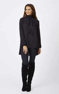 Pair this beautiful pussy bow blouse with a pair of sleek black boots and skinny jeans for a look thats both cute and sophisticated.