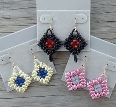 Earrings. Swarovski 4mm bicone-cut crystals, Superduo beads, and Miyuki glass…