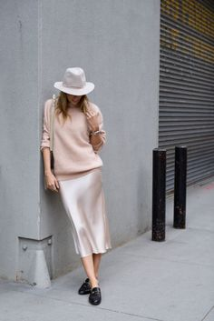 Blush sweater+blush satin midi skirt+black loafers+ivory and black shoulder bag+white hat. Winter Everyday Outfit 2017