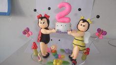 Topo de bolo jardim encantado na base de 14x8 cm oval. O número é vela de aniversário. R$40,00