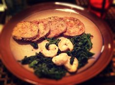 Sautéed kale with lemon shrimp and baked eggplant. Meatless