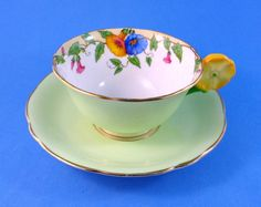 A dainty Aynsley flower handle with hand painted Morning Glory
