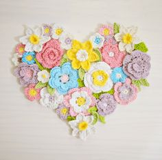 Crochet flower heart wall art decoration - patterns available on Etsy and featured in top creative crochet patterns for Spring