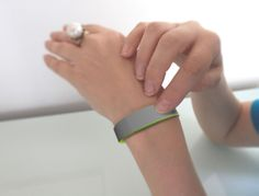 """far away are you two, this device senses your """"tap"""" and immediately transmits the gesture to another paired wristband, in this way, the othe..."""