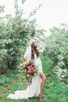 Ladder Decor with Fall Garlands for an Autumn Apple Orchard Session with Dramatic Bridal Style