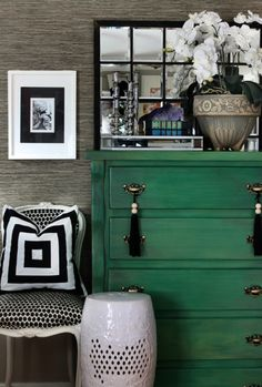 Painted emerald dresser drawers with black and white decorative accents