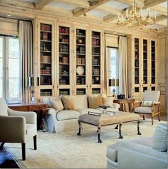 I will have to paint wood in one of our rooms to lighten it up, to something like the color here.    Bleached knotty pine library with powder blue upholstered furniture gives this wood paneled space a light, Scandinavian feel. Nice example of how to keep a library space open and airy without painting the wood.