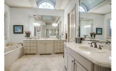 Lovely dual vanities with oversized mirrors!