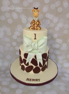 A 2 tier Giraffe themed cake, made to celebrate a little boys first birthday & christening. www.thecraftykitchen.co.uk #Giraffecake
