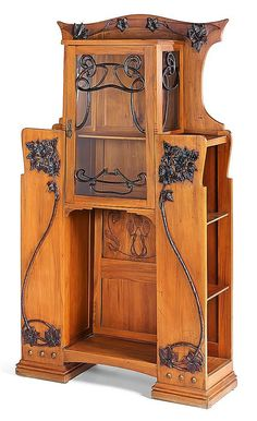Italian Art Nouveau display cabinet. Blonde ash with brass and stained wood ornaments.  79 3/8 X 43 3/4 X 14 5/8 in.