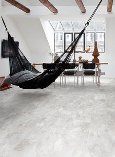 Arctic Slate Camaro luxury vinyl tile flooring, featured in dining room with hammock