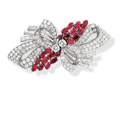 Diamond and Ruby Double Clip-Brooch, Van Cleef & Arpels   Platinum, white gold, the stylized bow motif centering 2 old European-cut diamonds approximately 1.00 ct., flanked by 2 cushion-shaped and 18 oval rubies, set throughout with 112 round, 6 single-cut and 36 baguette diamonds approximately 7.00 cts., signed Van Cleef & Arpels, NY, # 2089250, circa 1950