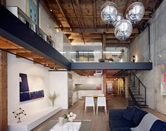 Amazing Warehouse Conversion- Click for more on the renovation process from the architects.