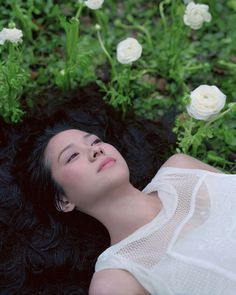 Izima Kaoru, Landscape with a Corpse  Izima Kaoru is a Japanese photographer currently living and working in Tokyo, Japan. Since 1993 he has been photographing actresses and models in staged fantasies of their perfect death.  He has each woman choose the designer clothes they want to be wearing when they die. The end results are these breathtaking scenes, where the very things that are disturbing are the same that make the photos so gripping.