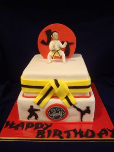 """Karate Birthday Cake - 10"""" bottom chocolate with raspberry buttercream and an 8"""" top tier, white also with raspberry buttercream. I charged $155 for this cake :) TFL!"""