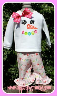 Girl Snowman Face Applique Design looks really cute on white minkee dot fabric aline dress with fabric ruffle on bottom