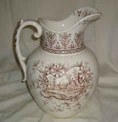 1850-1899. Marked  English J. H. Weatherby ironstone water pitcher with 'Orleans' pattern in brown transferware!!!! 12 in tall. Def old, notice all tiny tiny details in transferware. Fab for Thanksgiving and Christmas dinners as a pitcher or fab floral centerpiece!!