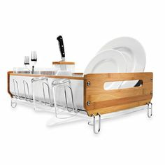 Finally, somebody thought about creating a goodlooking dish rack made of stainless steel and bamboo. No more rotting wood, as they drain via an adjustable tongue. Thank you Simple Human for creating this.