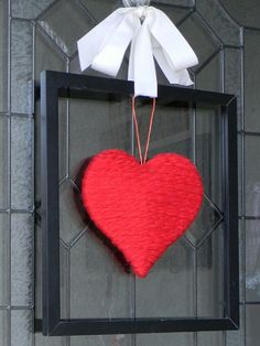 Valentine's Day Wreaths It says made of yarn but I would so with an old red sweater....How neat.