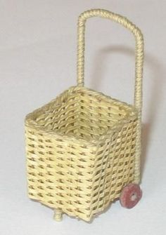 Jane Harrop demonstrates how to make a dolls house shopping trolley by weaving with paper, the technique of plaiting,  along with some extra materials.