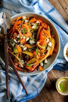 Carrot, Feta, and Pistachio Salad with Orange Blossom Toss recipe from @KaleandCaramel || Beautiful heirloom carrots thinly shaved and tossed with an incredible orange blossom scented dressing. || @thismessisours #glutenfree #vegetarian