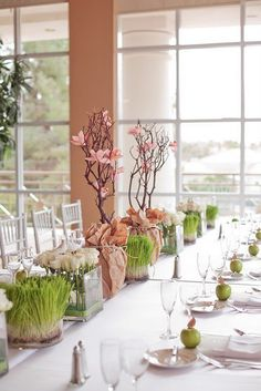 cute flower centerpiece Love the grass in vases!