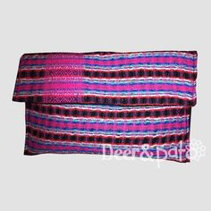 Upcycled clutch made of a repurposed Mayan woven blouse.