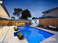 The work took eight months to complete and involved opening up the living space to include an al fresco area with BBQ kitchen, and a glass-fenced pool with a fully-tiled spa and outdoor projector (pictured)