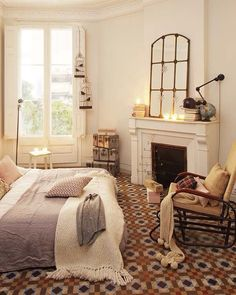 Traditional Master Bedroom with Fireplace, Paint 1, Carpet, Ballard designs: amiel arch antique mirror, Cement fireplace