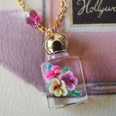 Gorgeous perfume bottle pendant ( So beautiful Thank you forever precious @Catarina Pereira <3 )